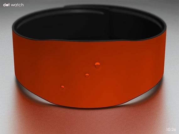Reloj estilo brazalete en color rojo con tres puntos que marcan el centro, la hora y los minutos en relieve.